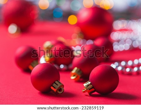 small red christmas balls on red  background - stock photo