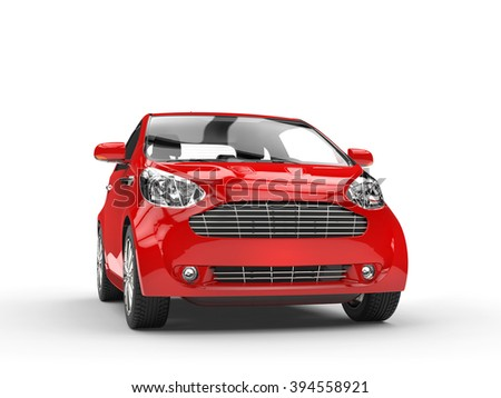 Small Red Compact Car - Front Headlight View - stock photo