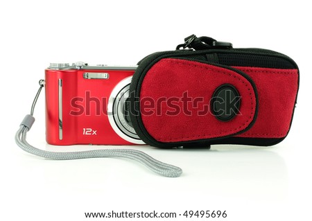 Small red compact digital camera being stored in a pouch for protection - stock photo