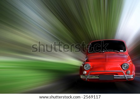 Small red generic car speeding in the country side. - stock photo