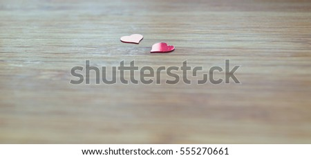 small red hearts on bamboo board