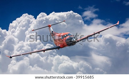 small red plane in the sky, in clouds - stock photo