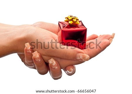 Small red present in woman's hands. Isolated on white - stock photo