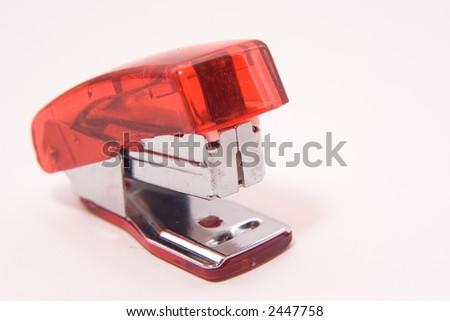 Small red stapler on white - stock photo