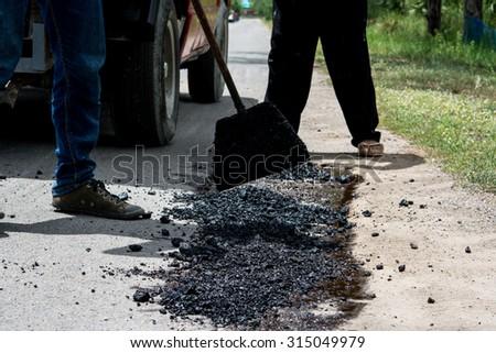 Small repair damaged roads - stock photo