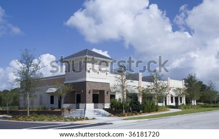 small retail strip mall with lush landscaping - stock photo