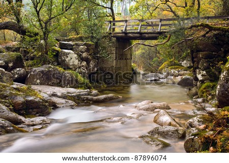 Small river at the portuguese national park of Geres in beautiful Autumn colors, Portugal - stock photo
