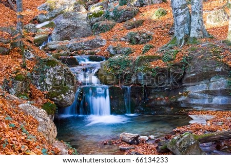 small river in a autumn mountains - stock photo