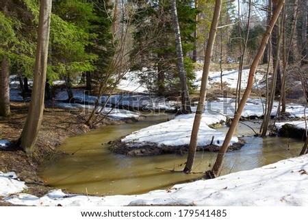 Small river in siberian forest at Spring time - stock photo