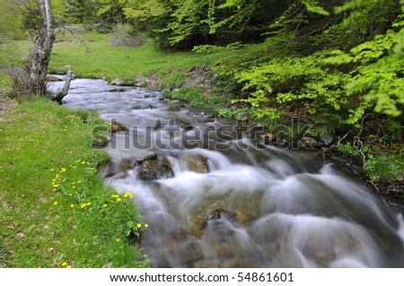 small river with stream - stock photo