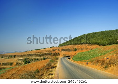 small road on the mountain - stock photo