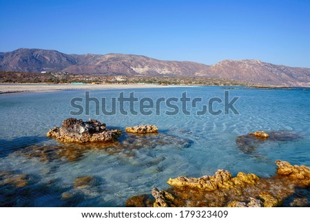Small rocks outcropping on the edge of Elafonisos beach - one of the most fabulous in Europe - on the southwest coast of Crete, Greece - stock photo