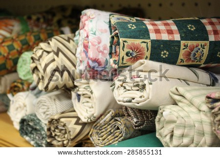 Small rolls of colorful fabric for a quilt. - stock photo