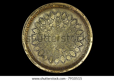 Small round brass tray with a pattern - stock photo