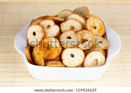 Small round mini bake rolls with a hole inside in a white bowl