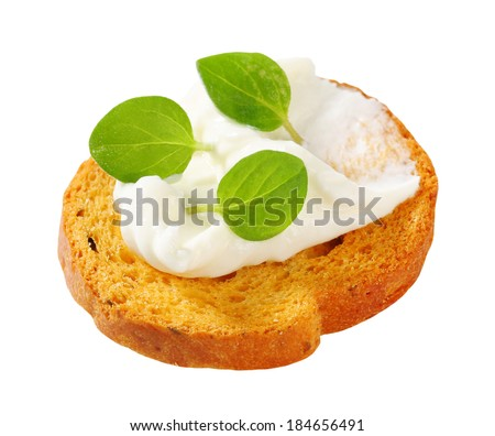 Small round toast with cheese spread