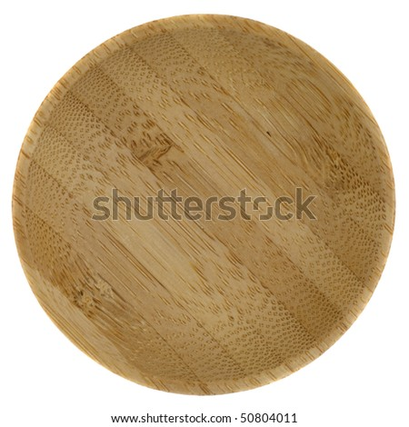 small round wooden bowl glued from pieces of exotic wood, isolated on white