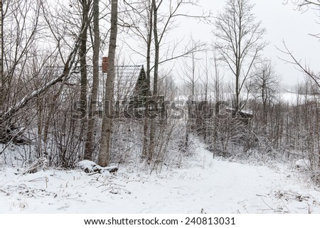 small rural cottage in winter in countryside