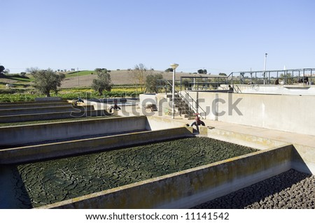 Small rural wastewater sanitation plant with sedimentation tanks - stock photo