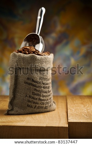 small sack fith coffee beans and scoop - stock photo