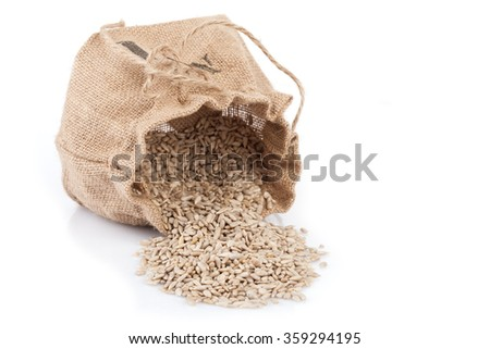 Small sack with sunflower seeds isolated on white background. - stock photo