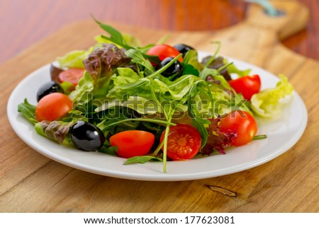small salad on plate - stock photo