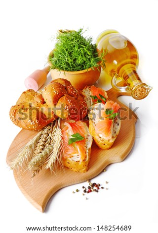 small salmon sandwiches served with vegetables  - stock photo