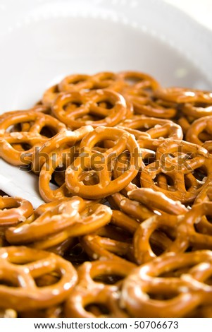 Small salt pretzels as a snack on the table. - stock photo