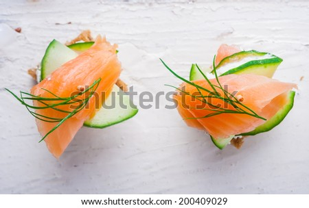 small sandwiches with salmon and cream cheese - stock photo