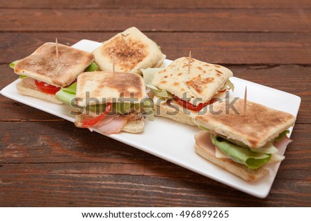 Small sandwiches with salmon, cheese and vegetables
