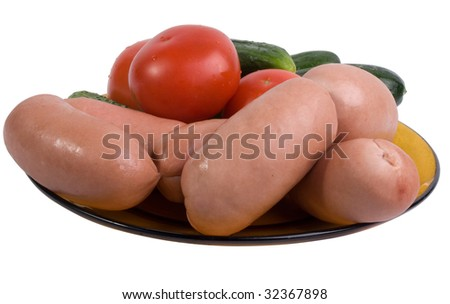 Small sausages with vegetables on a dish