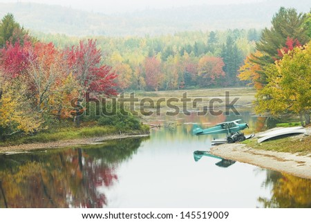 Small seaplane sits on pond near the Golden Road in Maine. - stock photo