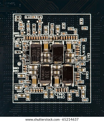 small semiconductor components on a black background - stock photo