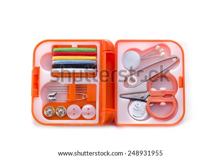 Small sewing kit in an orange case on a white background - stock photo