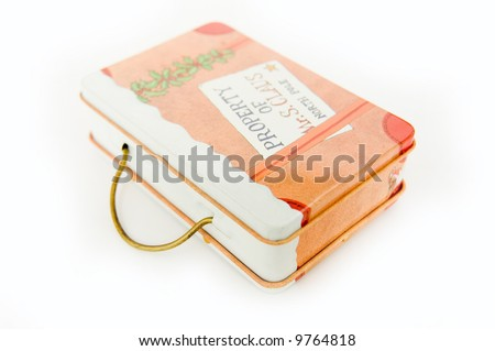Small sheet steel case with the ldrawings of teddy bear, angel, ... filled with coins and paper currency. - stock photo