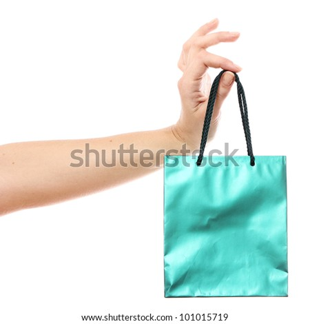 Small shopping bag in hand over white background - stock photo