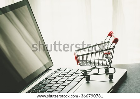 Small Shopping Cart On Laptop With Copyspace : Online Shopping Concept - stock photo