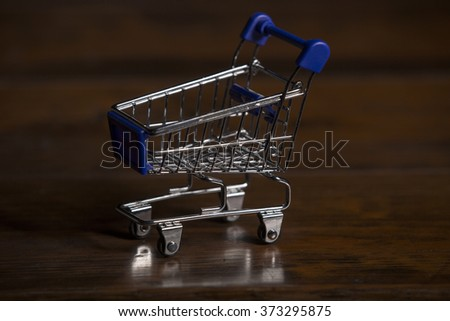 small shopping cart, studio picture - stock photo