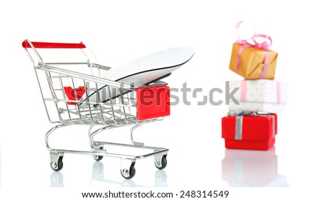 Small shopping cart with computer mouse and present boxes isolated on white - stock photo