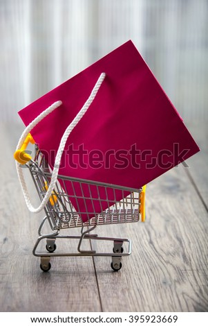 Small shopping cart with paper bag - stock photo