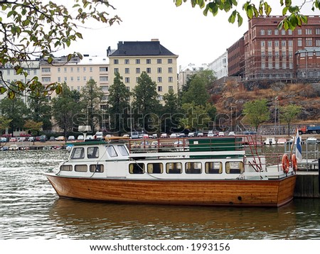 Small sightseeing ship waiting for customers, view - stock photo
