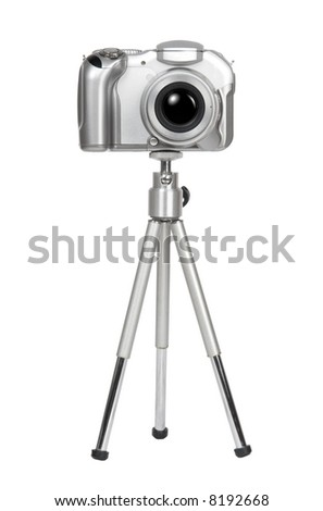 Small silver camera on a tripod. Isolated on white. - stock photo
