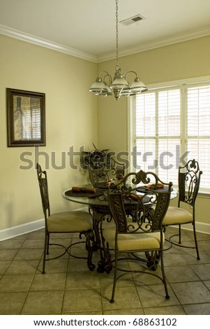 Small simple but stylish dinning room - stock photo