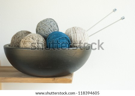small size balls of wool on desk - stock photo