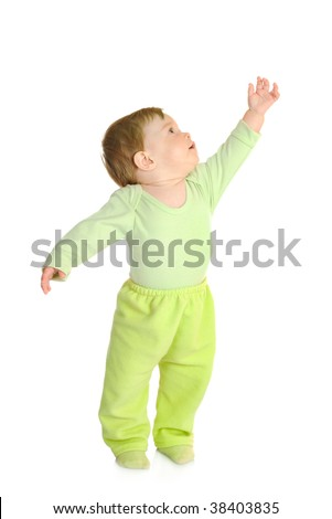 Small smiling baby in green isolated - stock photo