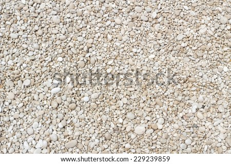 Small smooth pebbles texture background - stock photo