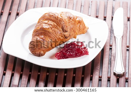 small snack - croissant and jam - stock photo