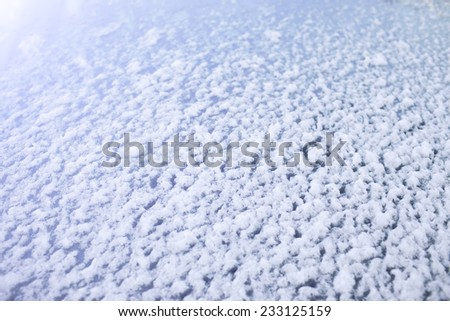 Small snow on car front glass - stock photo