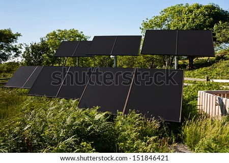 Small Solar farm in a rural countryside setting used to pump water for commercial agricultural use - stock photo