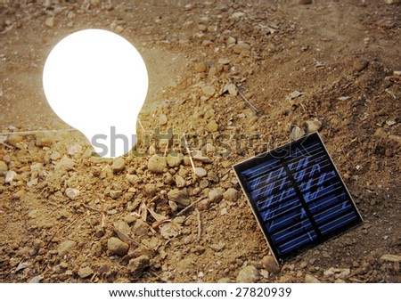 small solar panel and light bulb. - stock photo